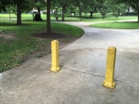 These bollards outside one of the side entrances to the Texas State Capitol are really to prevent cars from driving on the sidewalk. The more hardened standoff perimeter is in the background.