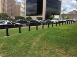 This row of bollards is from the standoff perimeter near one of the entrances to the Texas State Capitol. Bollards get a bad rep for being overused in long rows like this.